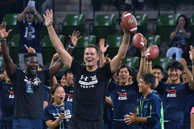 New England Patriots quarterback Tom Brady give instructions to young players at his American football clinic on Wednesday in Tokyo, Japan. The five-time Super Bowl champion Brady is on an Asian tour. Photo by Keizo Mori/UPI