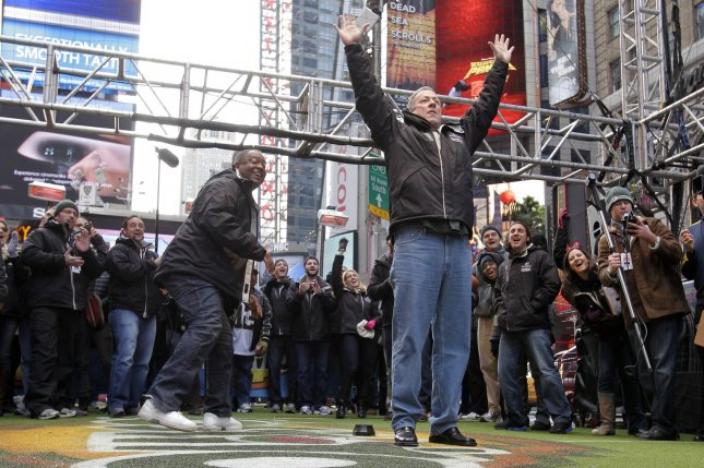 Jim Kelly kicks a field goal in Times Square in New York City. File photo by John Angelillo/UPI
