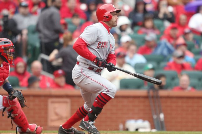 Cincinnati Reds first baseman Joey Votto hits an RBI single in the sixth inning against the St. Louis Cardinals on April 22 at Busch Stadium in St. Louis, Mo. Photo by Bill Greenblatt/UPI