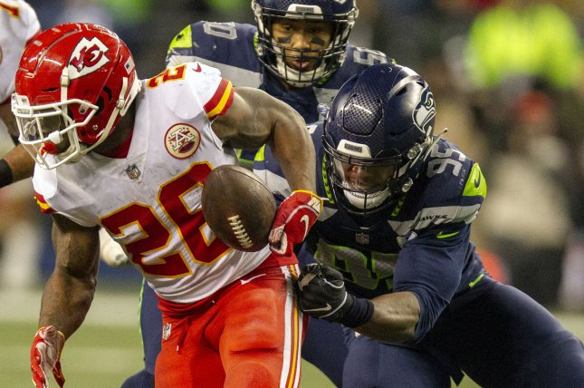 Kansas City Chiefs running back Damien Williams tries to hold on to the ball during a game against the Seattle Seahawks on December 23, 2018. Jim Bryant Photo/UPI