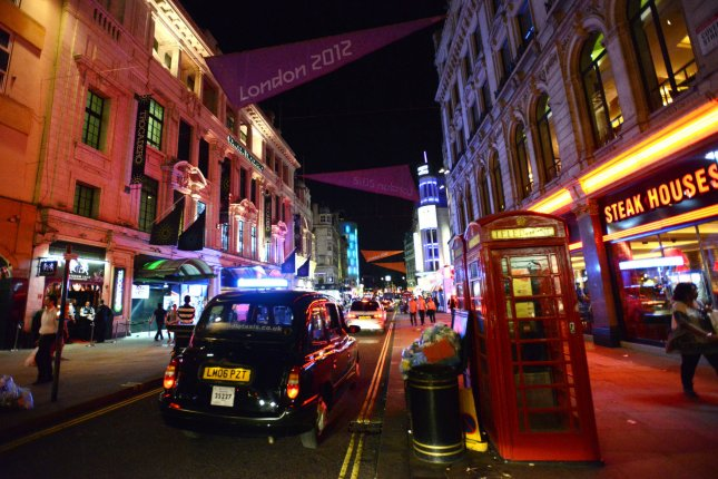 A classic British telephone booth adorns a street near Leicester Square in London on July 24, 2012. On January 6, 1927, commercial trans-Atlantic telephone service between New York and London was inaugurated. File Photo by Pat Benic/UPI