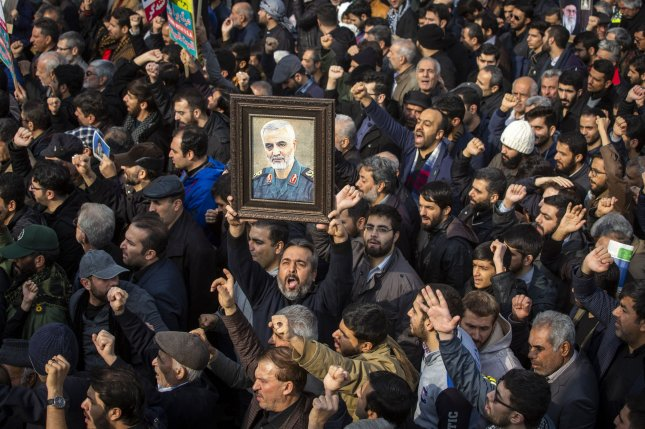 Thousands of Iranians take to the streets as they mourn the death of Iranian Revolutionary Guard Commander Qassem Soleimani on Friday. Photo by Maryam Rahmanian/UPI