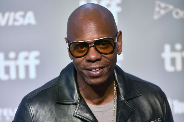 Dave Chapelle joined the Foo Fighters onstage during a concert at New York's Madison Square Garden that had a full-capacity crowd. File Photo by Christine Chew/UPI