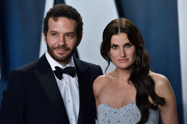 Idina Menzel (R), pictured with Aaron Lohr, will co-host the concert special Wicked in Concert. File Photo by Christine Chew/UPI