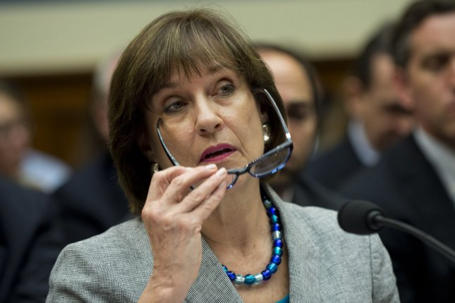 Lois Lerner, Director of Exempt Organizations for the Internal Revenue Service (IRS), invokes her fifth amendment right during a House Oversight and Governmental Reform Committee hearing on the IRS and its targeting of conservative groups, on Capitol Hill on May 22, 2013 in Washington, D.C. UPI/Kevin Dietsch