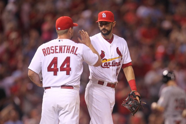 St. Louis Cardinals Matt Carpenter congratulates pitcher Trevor Rosenthal after making the third out against the Miami Marlins at Busch Stadium in St. Louis on August 14, 2015. ISt. Louis defeated Miami 3-1. Photo by Bill Greenblatt/UPI