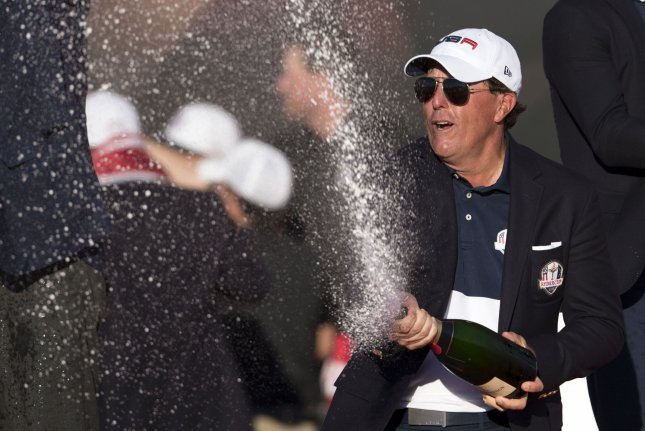 USA team member Phil Mickelson celebrates after the United States defeated Europe 17-11 to win the 2016 Ryder Cup at Hazeltine National Golf Club in Chaska, Minnesota on October 2, 2016. USA defeated Europe for the first time since 2008. Photo by Kevin Dietsch/UPI