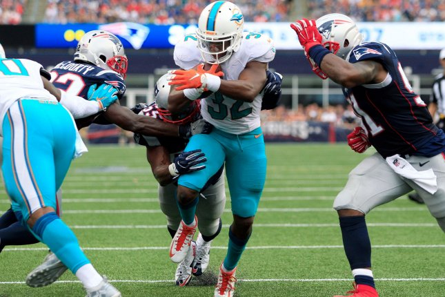Miami Dolphins running back Kenyan Drake (32). Photo by Matthew Healey/ UPI