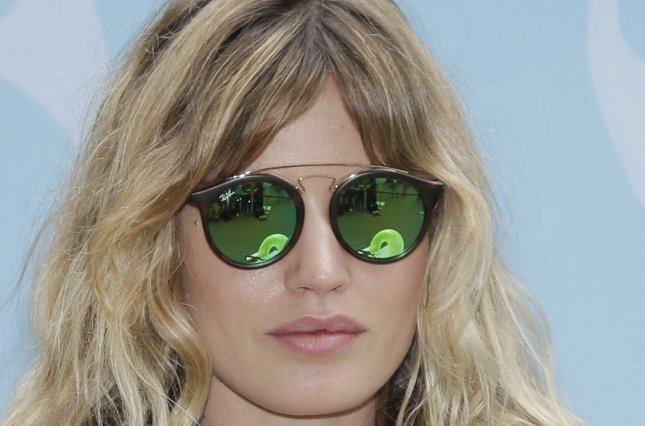 4dc530c892f8e Georgia May Jagger wears Ray-Ban glasses for a Sunglass Hut  Shades of You   campaign in Washington Square Park on June 16 in New York City.
