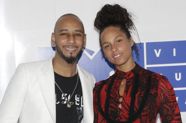 Alicia Keys (R) and Swizz Beatz attend the MTV Video Music Awards on August 28, 2016. The couple rang in their seventh wedding anniversary Monday. File Photo by John Angelillo/UPI