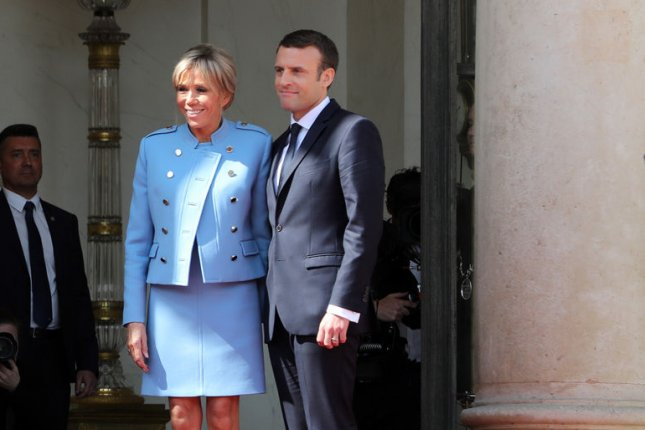 France's new president Emmanuel Macron poses with his wife, Brigitte, on the steps of the Elysee Palace in Paris. French voters have largely opposed a plan by Macron to issue his wife official job duties and a staff budget. Photo by Maya Vidon-White/UPI