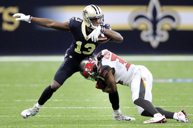New Orleans Saints wide receiver Michael Thomas (13) is tackled by Tampa Bay Buccaneers defensive back Robert McClain (36) after a short gain at the Mercedes-Benz Superdome on November 5 in New Orleans. Photo by AJ Sisco/UPI