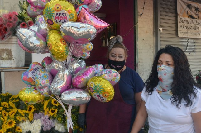 Shoppers wear masks at a mall in downtown Los Angeles where the food court and some other businesses were open on May 8. Photo by Jim Ruymen/UPI