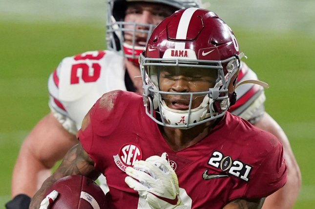 Former Alabama wide receiver DeVonta Smith is expected to be one of the first wide receivers selected in the 2021 NFL Draft, but faces skepticism because of his small stature compared to other playmakers in the class. File Photo by Hans Deryk/UPI