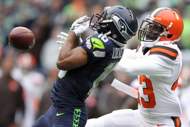 Seattle Seahawks wide receiver Tyler Lockett (16) has the ball knocked away by Cleveland Browns free safety Jordan Poyer at CenturyLink Field in Seattle, Washington on November 29, 2015. The Seahawks clinched their fourth straight playoff berth in four seasons by beating the Browns 30-13. Photo by Jim Bryant/UPI