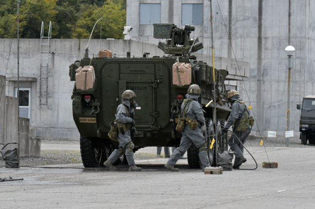 Members of Japan's Self-Defense Force conduct a joint military exercise. After years of postponement, Tokyo and Seoul are nearing a deal to share miliitary intelligence, according to the South Korean government. File Photo by Keizo Mori/UPI
