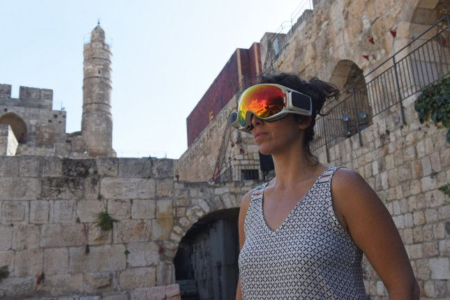A woman wears an AR/VR headset during the launch of the Innovation Lab in the Tower of David Museum in the Old City of Jerusalem. Photo by Debbie Hill/UPI