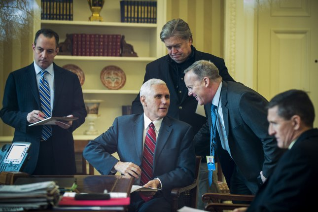 Other than Vice President Mike Pence (2nd-L), all the men in this photograph left the Trump administration during its first year, including Reince Priebus (L), Steve Bannon (C), Sean Spicer (2nd-R) and Michael Flynn (R). File Photo by Pete Marovich/UPI