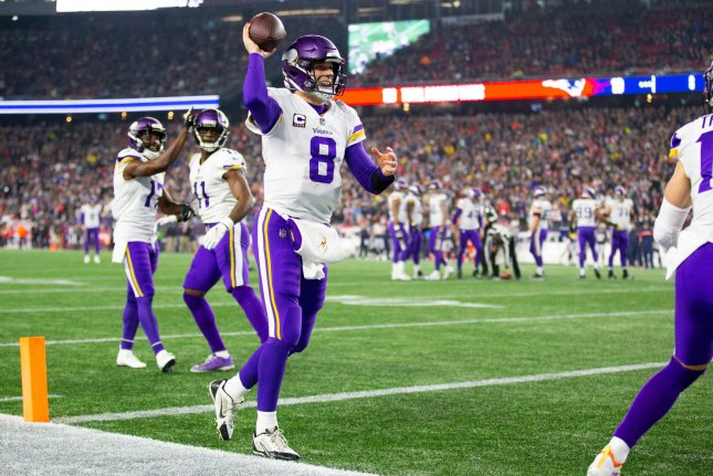 Minnesota Vikings quarterback Kirk Cousins (8) celebrates with Adam Thielen (19) after the two connected for a touchdown in the second quarter against the New England Patriots on December 2, 2018 at Gillette Stadium in Foxborough, Massachusetts. Photo by Matthew Healey/UPI