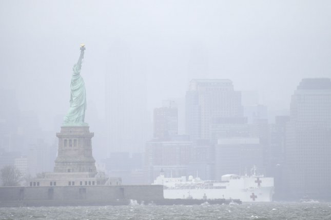 The USNS Comfort Navy passes the Statue of Liberty in the Hudson River on Thursday in New York City. The floating hospital arrived in March to aid hospitals that were overwhelmed with coronavirus patients. Photo by John Angelillo/UPI
