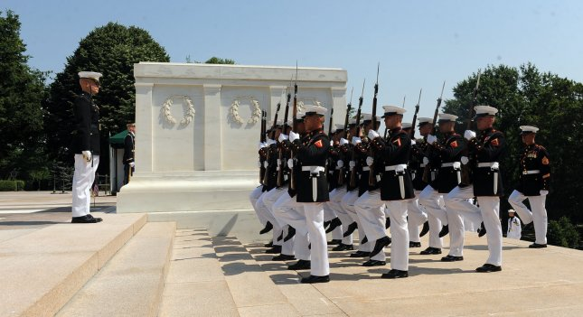 Marine Corps Honor Guards arrive for a Wreath Laying Ceremony at the Tomb of the Unknowns in Arlington National Cemetery on Memorial Day in Arlington, Virginia, on May 30, 2011. UPI/Roger L. Wollenberg