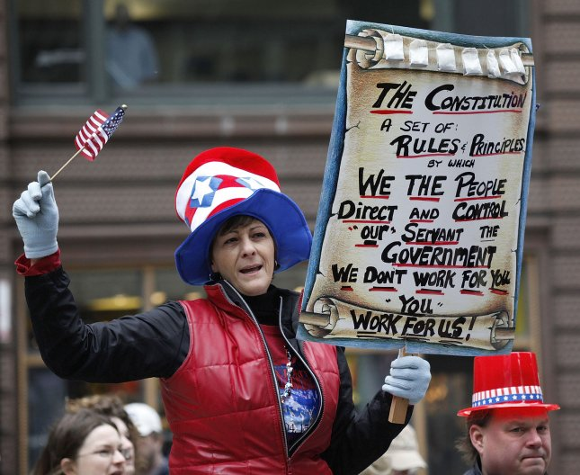 Marianne Ruiz of McHenry, Illinois holds up a sign at a tea party anti-tax protest in Federal Plaza on April, 15, 2009 in Chicago. Thousands attended the Chicago rally and hundreds of other protests were organized in cities across the country on national tax day to express concern over excess government spending. (UPI Photo/Brian Kersey)