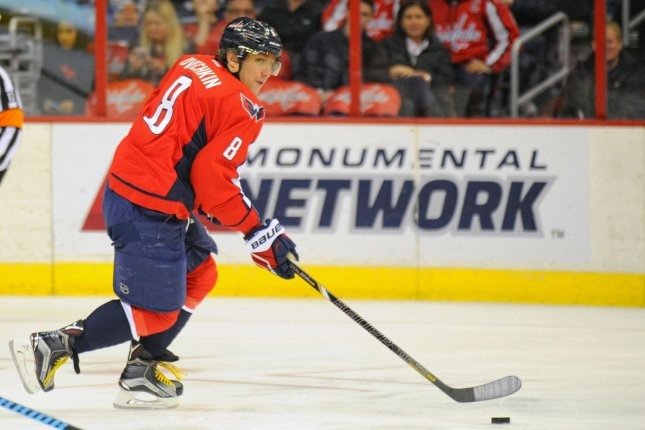 Washington Capitals left wing Alex Ovechkin (8) skates up ice against the Vancouver Canucks in the first period at the Verizon Center in Washington, D.C. on December 2, 2014. UPI/Mark Goldman