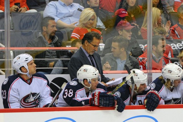 Columbus Blue Jackets head coach John Tortorella looks at his notes in the first period at the Verizon Center in Washington, D.C. File photo by Mark Goldman/UPI