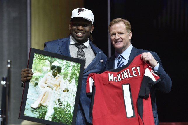 Takkarist McKinley poses for photographs with NFL Commissioner Roger Goodell after being selected by the Atlanta Falcons as the 26th overall pick in the 2017 NFL Draft at the NFL Draft Theater on April 27 in Philadelphia, Pa. File photo by Derik Hamilton/UPI