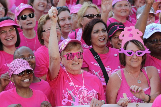 Breast cancer survivors march through the streets of downtown St. Louis during the 18th annual the Susan G. Komen Race for the Cure on June 11, 2016. New research suggests fewer women diagnosed with early stage breast cancer are receiving chemotherapy. Photo by Bill Greenblatt/UPI