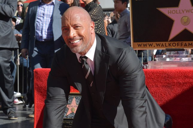 Dwayne Johnson was among many celebrities posting family photos on Christmas. File Photo by Jim Ruymen/UPI