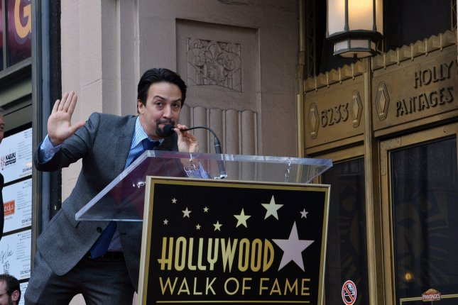 American composer, lyricist, playwright, rapper, and actor Lin-Manuel Miranda (C), best known for creating and starring in the Broadway musicals In the Heights and Hamilton, makes comments during an unveiling ceremony honoring him with the 2,652nd star on the Hollywood Walk of Fame in Los Angeles on Friday. Photo by Jim Ruymen/UPI