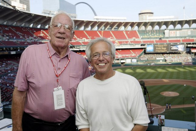 The Cincinnati Reds broadcast team featured Hall of Famer Marty Brennaman (R) and former pitcher Joe Nuxhall for nearly 30 years. File photo by Bill Greenblatt/UPI