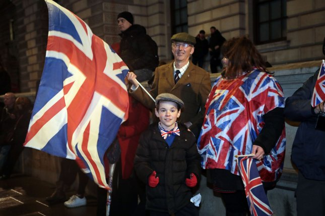 Brexit supporters celebrate leaving the European Union as they congregate in Parliament Square Dec. 31. The Home Office said Friday that more than 3.3 million European Union residents can remain in Britain after Brexit. Photo by Hugo Philpott/UPI