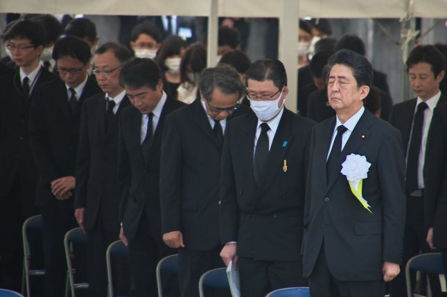 A recent survey indicates the Japanese public may not be satisfied with Japanese Prime Minister Shinzo Abe (R) and his handling of the coronavirus. File Photo by Kezio Mori/UPI