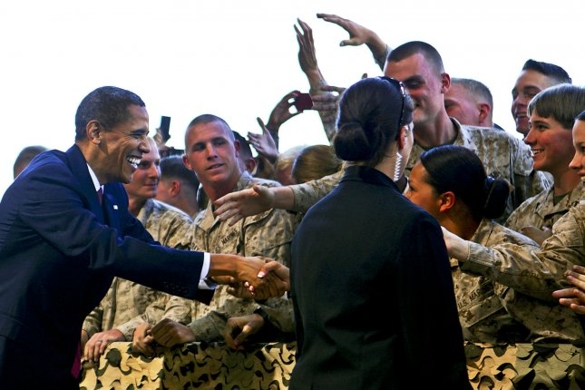 President Barack Obama is greeted by U.S servicemen and women at Marine Corps Base Camp Pendleton, California, August 7, 2013. Obama said he holds a special place in his heart for Marines, as he is constantly surrounded and protected by them. UPI/James Mercure/DOD