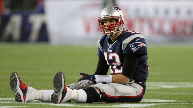 New England Patriots quarterback Tom Brady (12) sits on the field after a turn over on downs in the fourth quarter against the Baltimore Ravens in the AFC Championship game at Gillette Stadium in Foxborough, Massachusetts on January 20, 2013. The Ravens defeated the Patriots 28-13. UPI/Matthew Healey