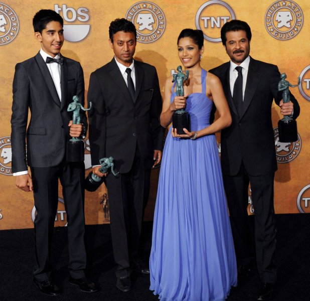 Members of the cast of Slumdog Millionaire appear backstage with the award for outstanding performance by a cast in a motion picture at the15th Annual Screen Actors Guild Awards in Los Angeles on January 25, 2009. From left are, Dev Pate, Irrfan Khan, Freida Pinto and Anil Kapoor. (UPI Photo/Jim Ruymen)