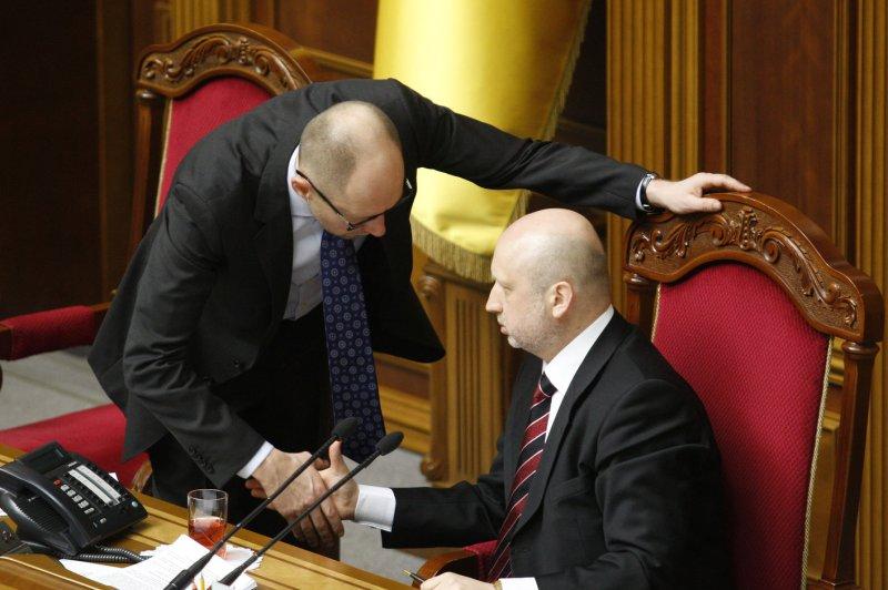 Ukrainian Prime Minister Arseniy Yatsenyuk (L) talks to Acting President Oleksandr Turchynov in the parliament in Kiev on March 11, 2014. (UPI/Ivan Vakolenko)