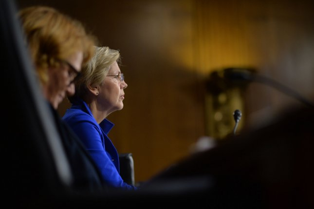 Sen. Elizabeth Warren (D-MA) listens as Federal Reserve Board Chairwoman Janet Yellen testifies on the Federal Reserve's Semiannual Monetary Policy Report to the Congress, during a Senate Banking, Housing and Urban Affairs Committee hearing in Washington, D.C. on July 15, 2014. UPI/Kevin Dietsch