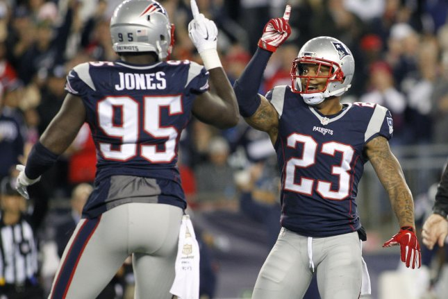 New England Patriots defensive end Chandler Jones (95) celebrates with safety Patrick Chung (23) after Jones sacked Miami Dolphins quarterback Ryan Tannehill (17) in the second quarter at Gillette Stadium in Foxborough, Massachusetts on October 29, 2015. Photo by Matthew Healey/ UPI