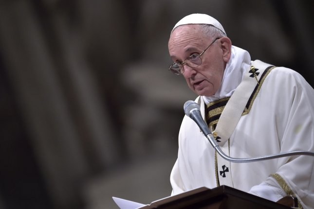 Pope Francis, shown here celebratings Christmas Eve Mass at the Vatican, said Sunday that Christians have a lot to apologize for, in particular the church's treatment of gay people and those exploited by the church. File Photo by Stefano Spaziani/UPI