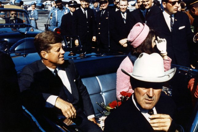 Texas Gov.r John Connally (foreground) adjusts his tie as President John F. Kennedy and his wife, Jackie, prepare for their tour of Dallas on November 22, 1963. The president would later be shot and killed while his motorcade made its way through Dealey Plaza. UPI File Photo
