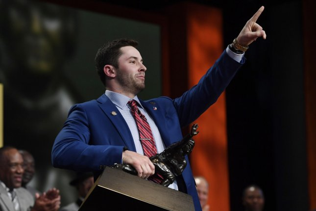 Baker Mayfield reacts after he wins the 2017 Heisman Trophy during the Heisman Trophy Presentation on December 9, 2017 in New York City. Photo by Todd J. Van Emst/Heisman Trust/Pool