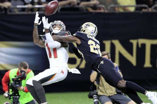 New Orleans Saints cornerback Ken Crawley (20) knocks the ball away from Tampa Bay Buccaneers wide receiver DeSean Jackson (11) at the Mercedes-Benz Superdome in New Orleans. File photo by AJ Sisco/UPI