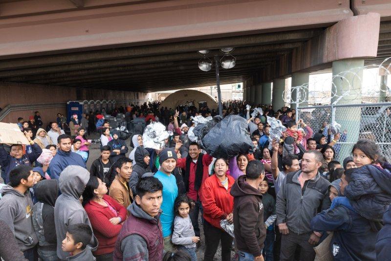 Migrants are held for processing under the Paso del Norte Bridge in El Paso, Texas on March 27. File Photo by Justin Hamel/UPI