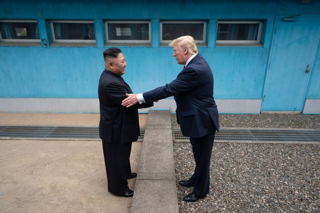 U.S. President Donald Trump shakes hands with Chairman of the Workers' Party of Korea Kim Jong Un on June 30 as the two leaders meet at the Korean Demilitarized Zone. White House Photo by Shealah Craighead/UPI
