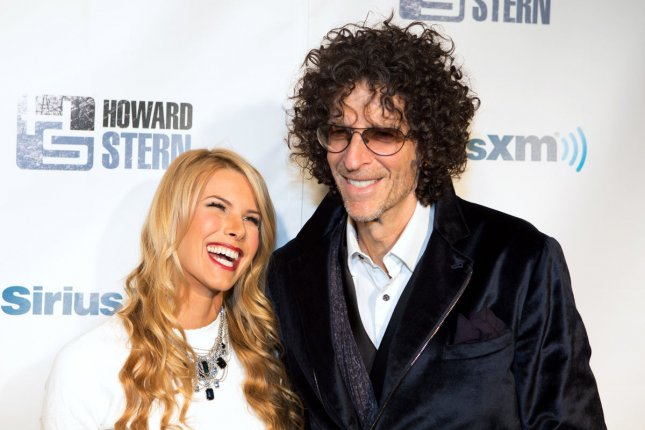 Howard Stern (R) -- seen here with his wife Beth -- signed a new deal to stay at Sirius for five more years. File Photo by Justin Alt/UPI