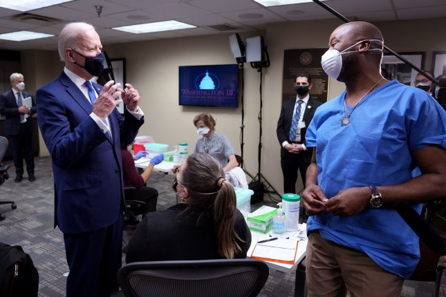 President Joe Biden greets a COVID-19 vaccine recipient as he visits a Veterans Affairs (VA) COVID-19 vaccination center in Washington on Monday, March 8, 2021. Photo by Kevin Dietsch/UPI