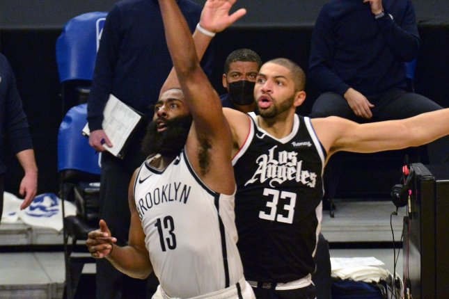 Brooklyn Nets guard James Harden (L), shown Feb. 21, 2021, suffered a hamstring injury during the first minute of Game 1 against the Milwaukee Bucks last week. File Photo by Jim Ruymen/UPI
